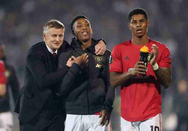 FILE PHOTO: Manchester United manager Ole Gunnar Solskjaer celebrates with Anthony Martial and Marcus Rashford their Europa League match against Partizan Belgrade
